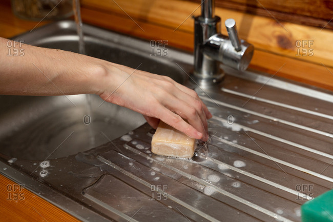 Woman washes her hands to protect against the covid-19 virus