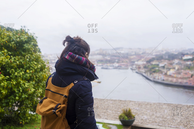 Rear view of a woman watching panoramic view of PortoPortugal