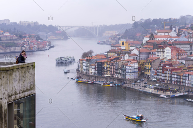 March 3, 2018: Rear view of a woman watching panoramic view of PortoPortugal