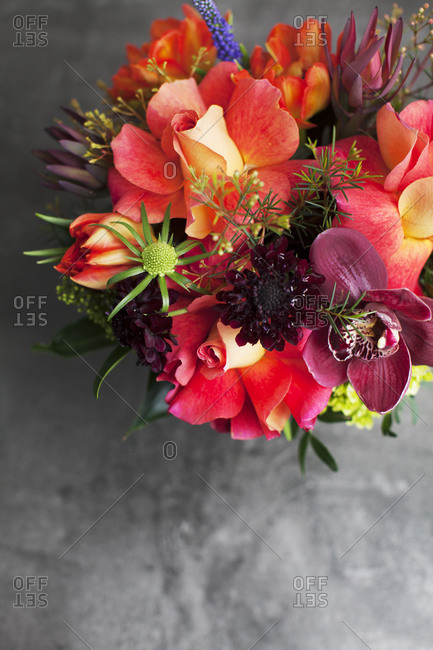 Aerial view of floral arrangement with orange roses and orchids