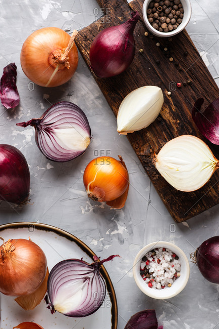 Various sorts of onions over gray background