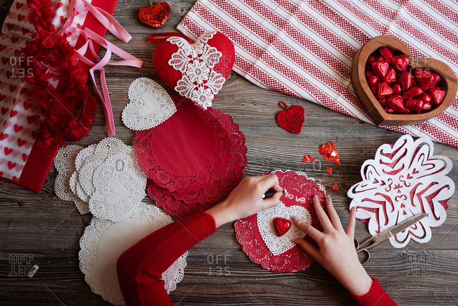 Flat lay overhead image of a young girl making valentines