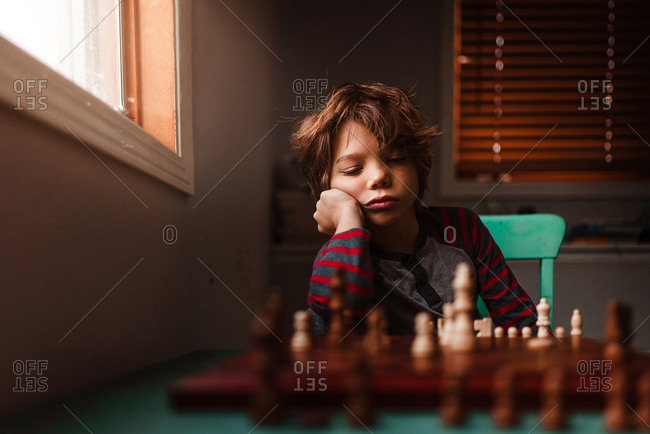 A young boy playing chess