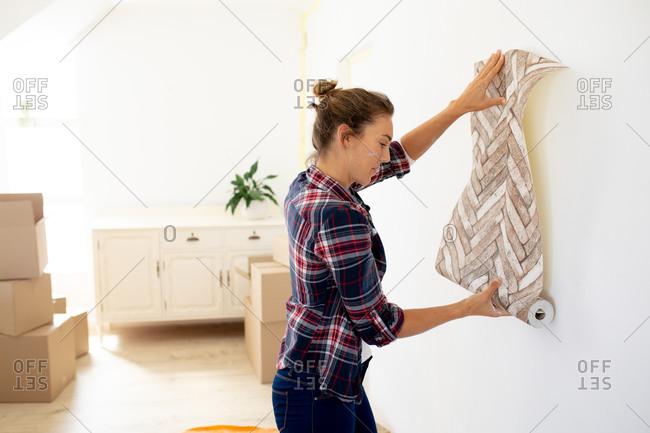 Caucasian woman spending time at home self isolating and social distancing in quarantine lockdown during coronavirus covid 19 epidemic, posing wallpaper.