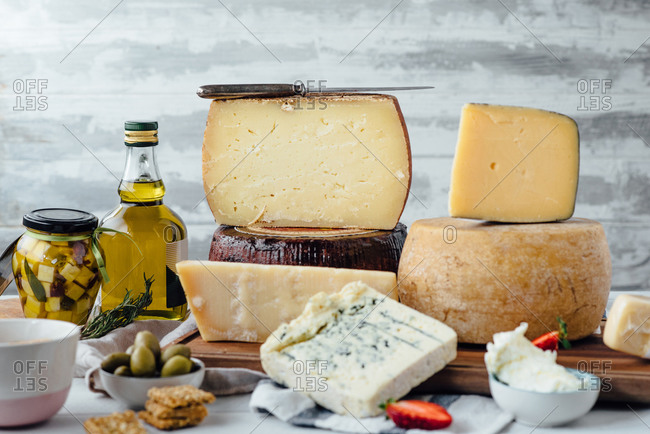 A variety of cheese and fruit with olive oil