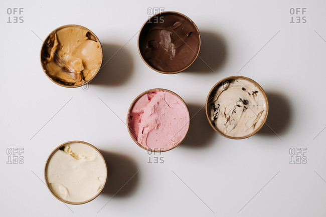 Tubs filled with various flavors of ice cream