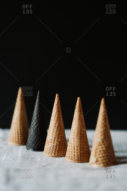 Sugar cones placed upside down in front of dark background
