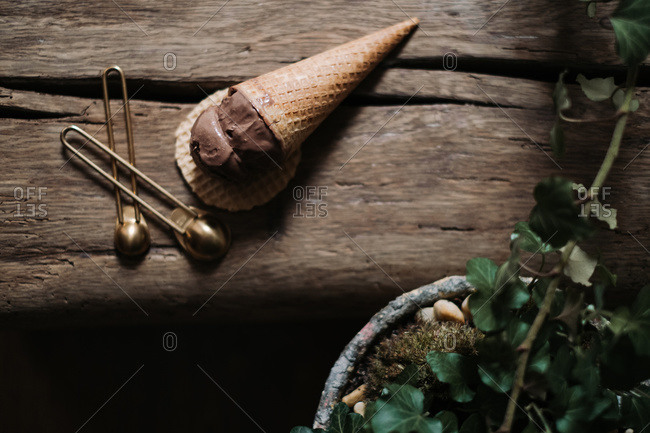 Overhead view of a chocolate scoop of ice cream in a cone on a wafer crisp