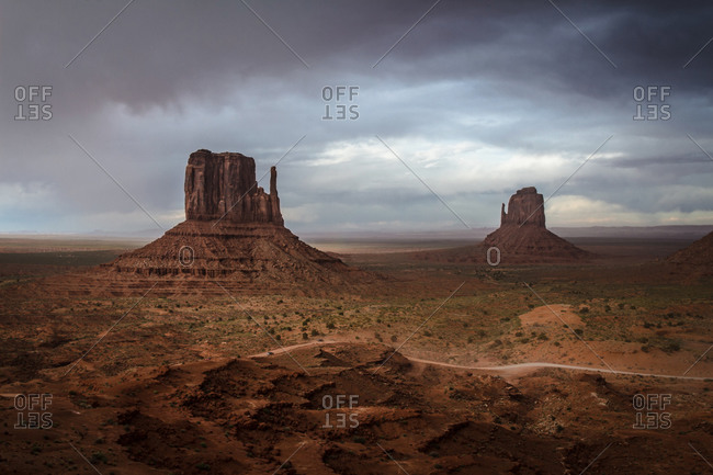 An incoming storm in the background of the scenic view of The Mittens and Merrick Butte in the Oljato Navajo Monument Valley, Arizona, USA