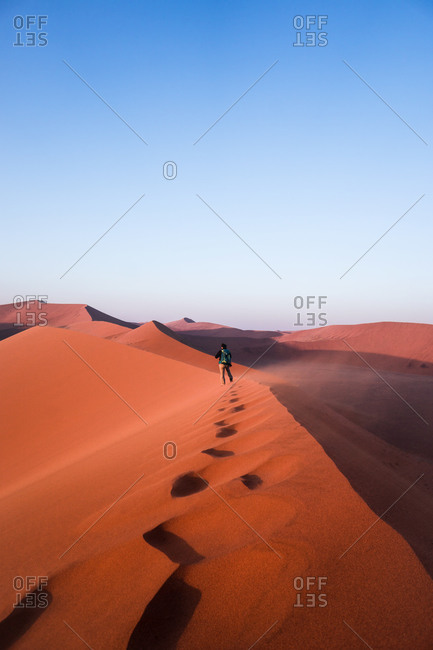 A person walking on the top of Dune 45, Namib Naukluft National Park, Namibia, Africa