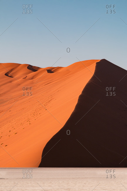 Orange desert dune lateral view at sunrise, Namib Naukluft National Park, Sesriem, Namibia, Africa