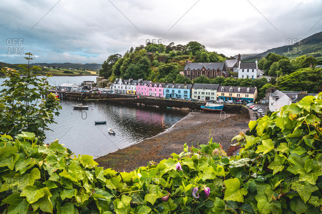 Isle of Skye, Highland Region, Scotland - June 9, 2019: Row of houses at the harbor of Portree