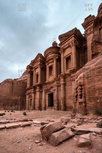 Al Deir Monastery facade view in a cloudy day in Petra, Jordan