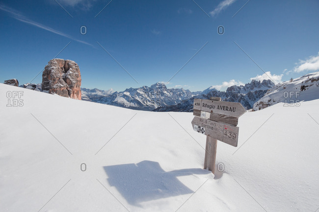 Sign along the path to the Cinque Torri peaks in a sunny winter day, Dolomites, Cortina d'Ampezzo, Cadore, Veneto, Italy