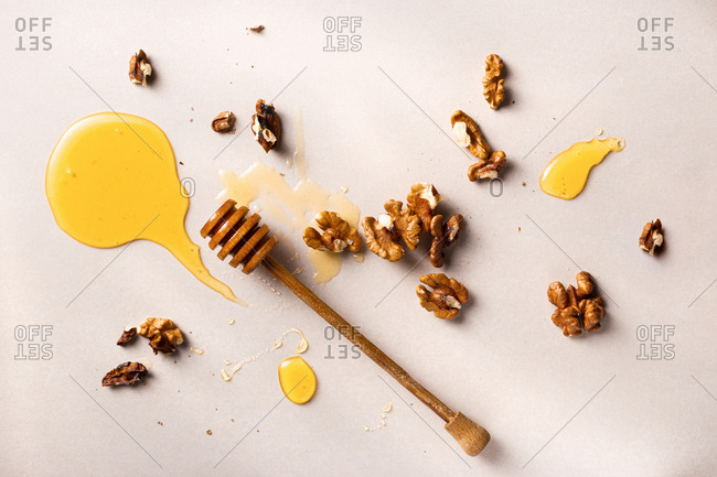 Honey stick with homemade honey and nuts top view