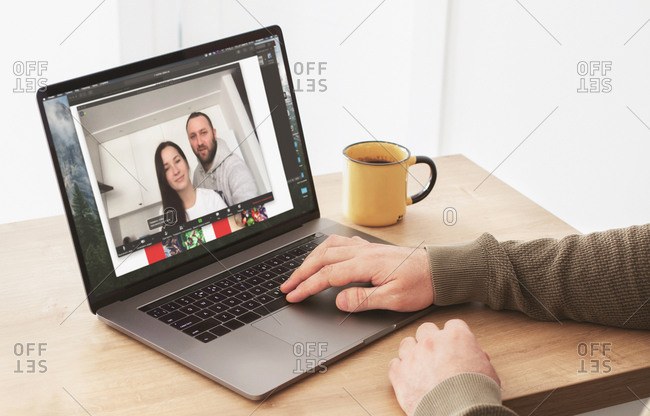 Best friends talk among themselves through video call while sitting in home