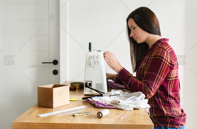 Caucasian attractive woman tailor sewing at home