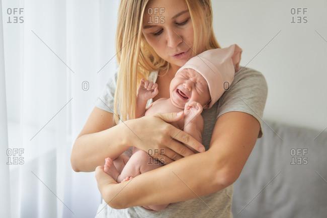 Mother comforting newborn baby girl