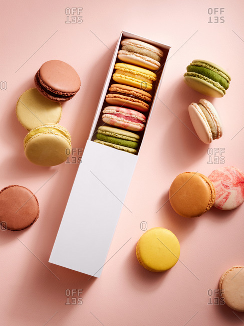 Top view of various assorted flavors of classic French macarons in a gift box
