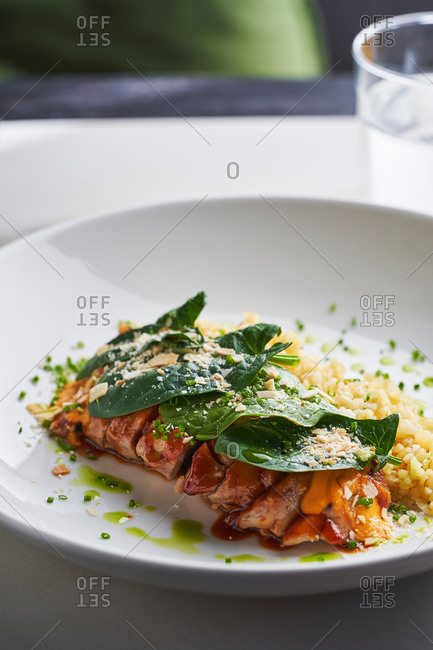 Juicy tender duck breast with spinach leaves and crushed nuts