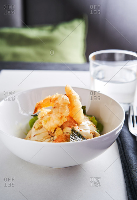 Japanese-style deep fried shrimps on light background in a restaurant setting