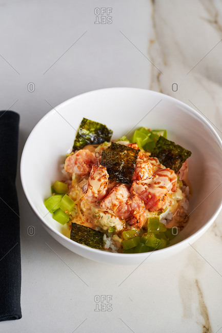 Modern dish of salmon tartare with nori and sesame oil