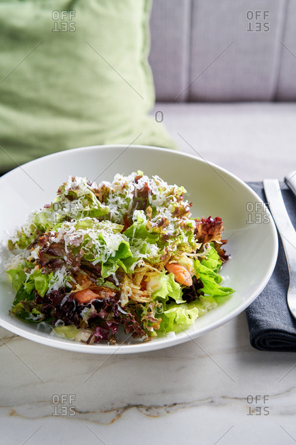Mixed greens salad with grated parmesan cheese
