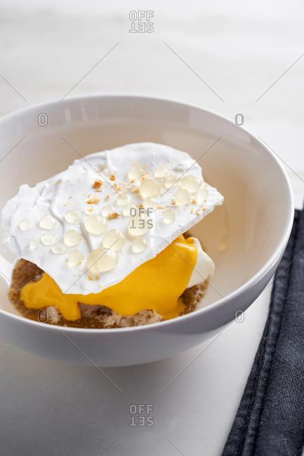 Fancy modern dessert with meringue and lemon gel