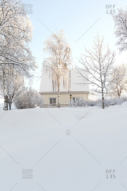 White wooden house in snowy landscape