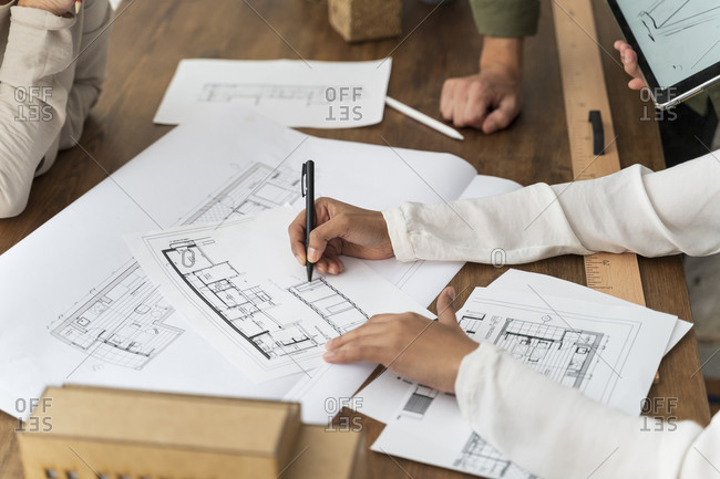Close-up of colleagues working in architectural office