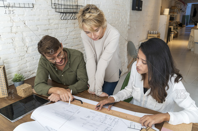 Colleagues discussing in architectural office