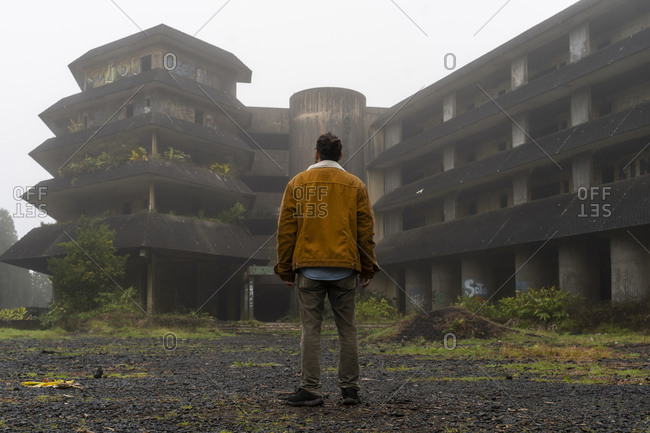 Rear view of man standing at abandoned building- Sao Miguel Island- Azores- Portugal