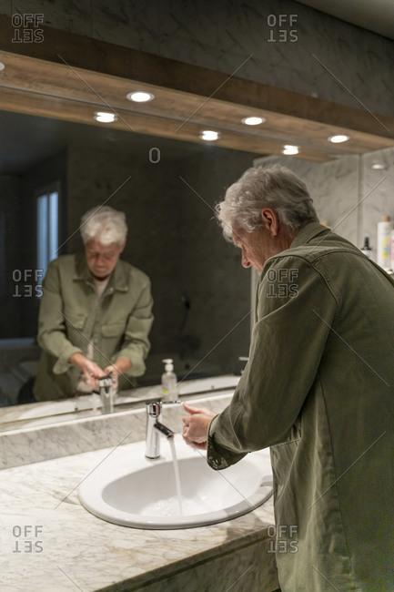 Man washing hands in bathroom