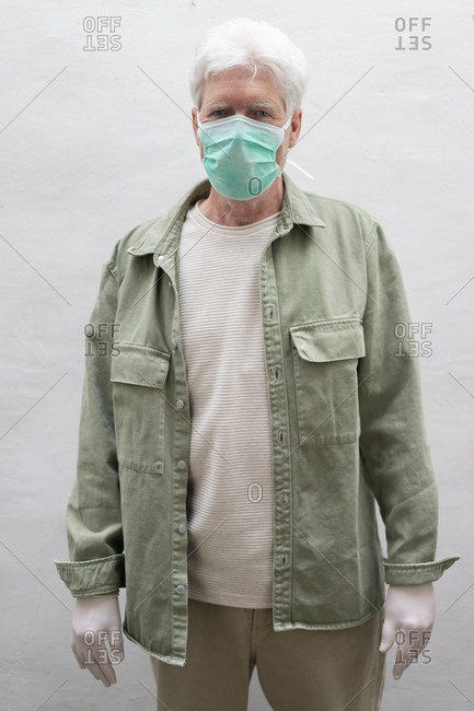 Senior man wearing face mask and protective mask