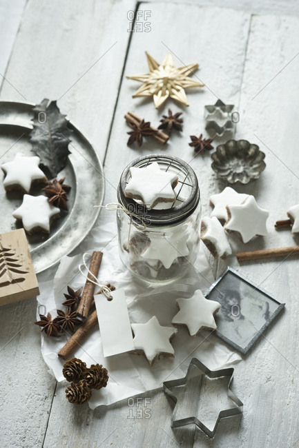 Star shaped cookies- cinnamon sticks- old photograph- pine cones- cookie cutter- star anise- glass jar and Christmas decorations