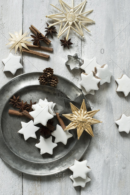 Star shaped cookies- cinnamon sticks- pine cones- cookie cutter- pewter plate- star anise and straw Christmas decorations