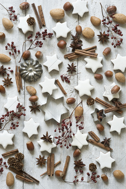 Star shaped cookies- cinnamon sticks- star anise- cookie cutters- pine cones- rose hips- almonds and hazelnuts