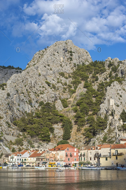 August 12, 2017: Croatia- Omis- Town on bank of Cetina river with tall hill in background