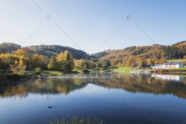 Germany- North Rhine-Westphalia- Clear sky over Eiserbachsee lake at sunny autumn day