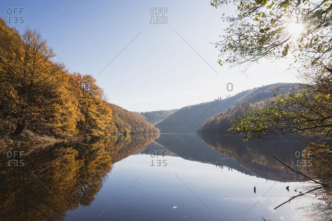 Germany- North Rhine-Westphalia- Clear sky over shiny Obersee lake in autumn