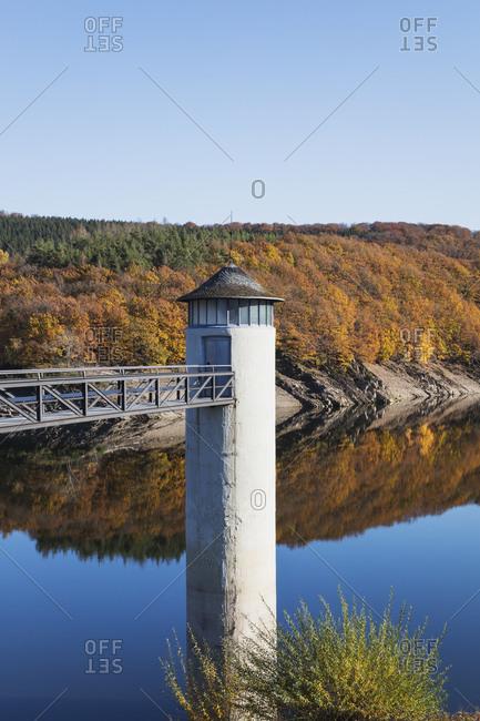 Germany- North Rhine-Westphalia- Clear sky over Urft Dam in autumn