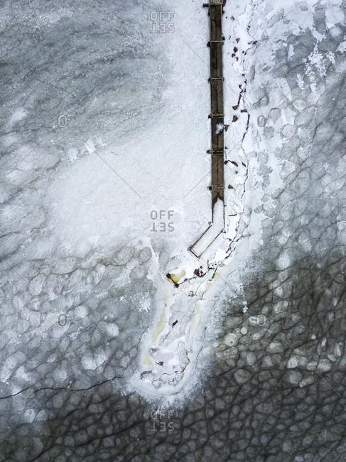 Russia- Saint Petersburg- Sestroretsk- Aerial view of empty pier on frozen shore of Gulf of Finland