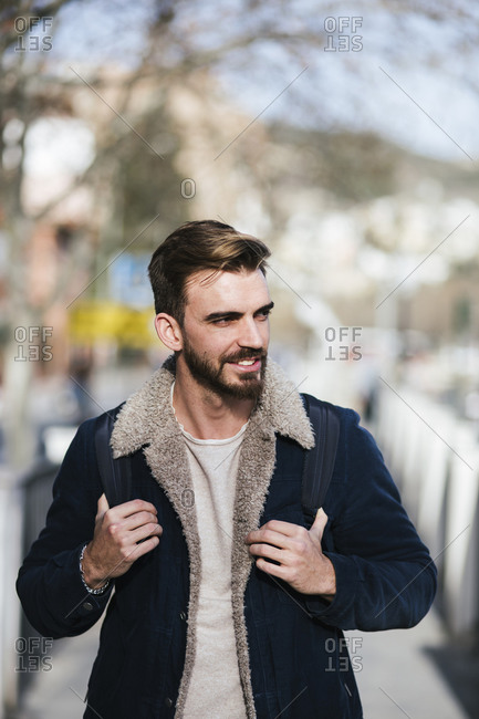 Portrait of smiling man in the city on the go