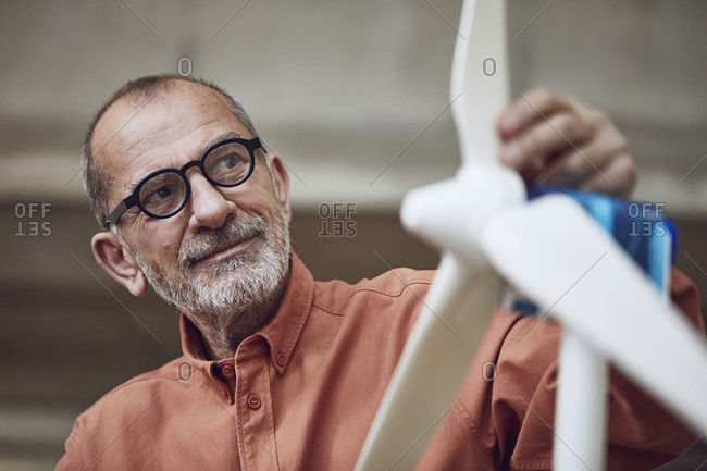 Senior engineer working on wind energy solutions- looking at wind turbine