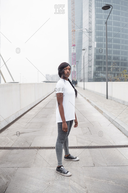 Sportive young woman posing in the city
