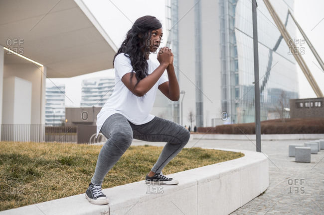 Sportive young woman training in the city