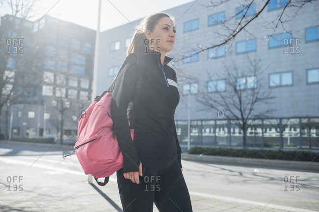 Sporty young woman walking in the city