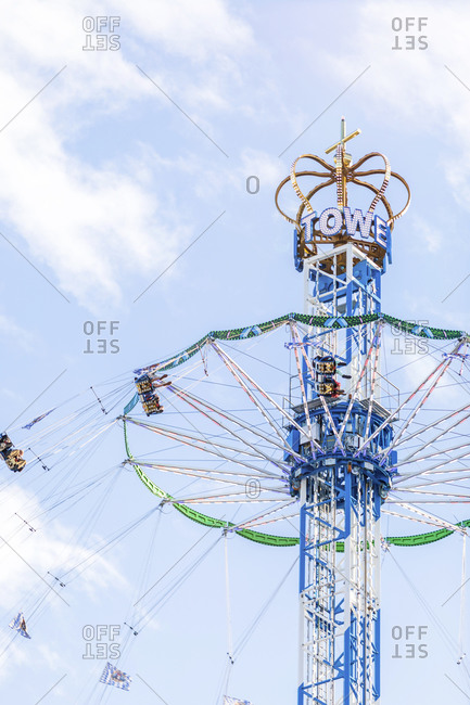 January 21, 2020: Germany- Bavaria- Munich- Low angle view of Bayern Tower chain swing ride standing against sky