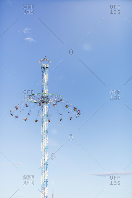 January 21, 2020: Germany- Bavaria- Munich- Low angle view of Bayern Tower chain swing ride standing against clear sky