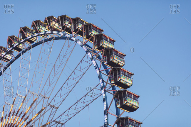 January 21, 2020: Germany- Bavaria- Munich- Low angle view of Ferris wheel standing against clear sky